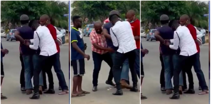 Police officers struggle to handcuff a driver over license